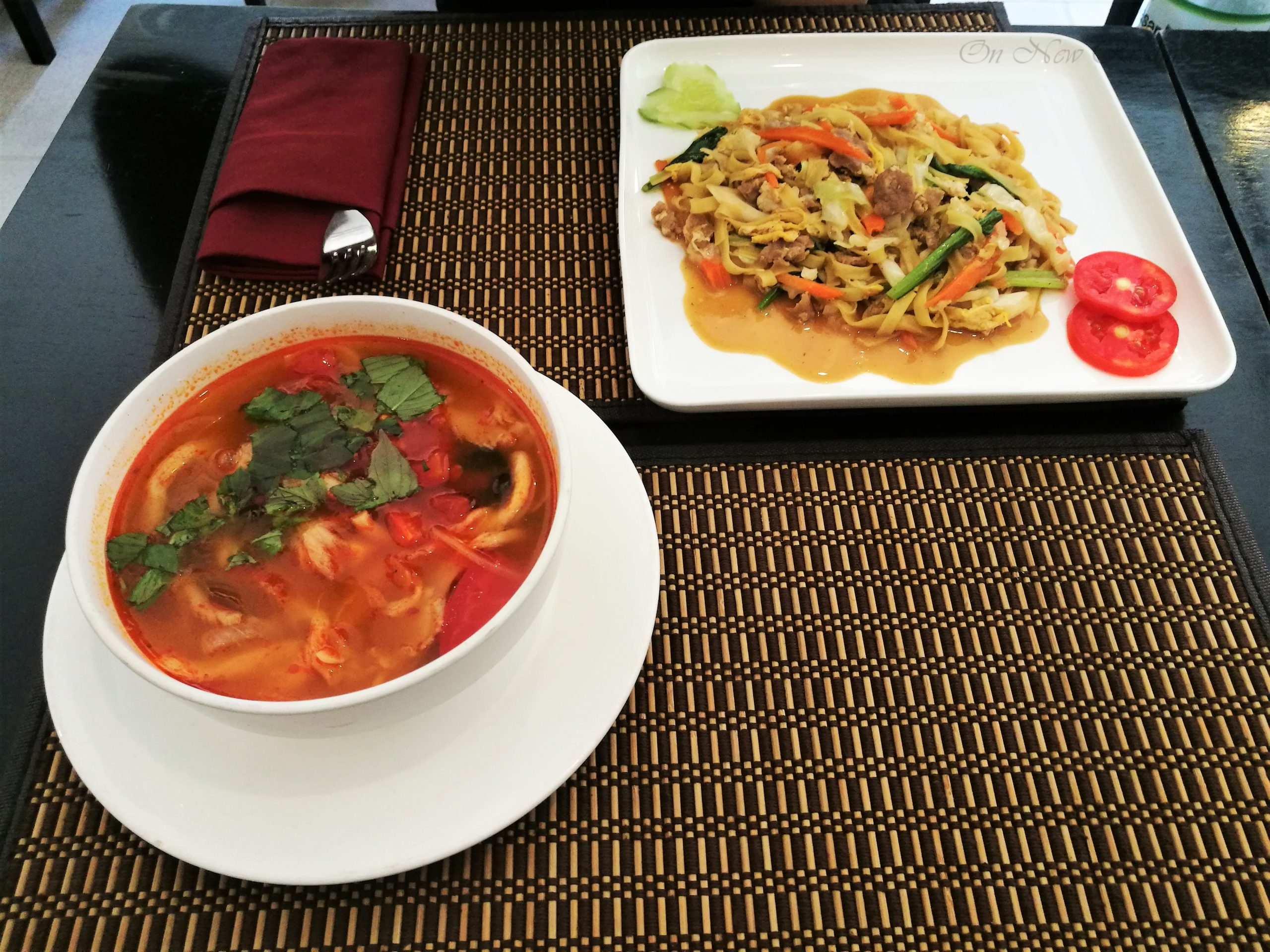 Tom-Yum-soup-and-pork-fried-noodles-Cambodia-scaled